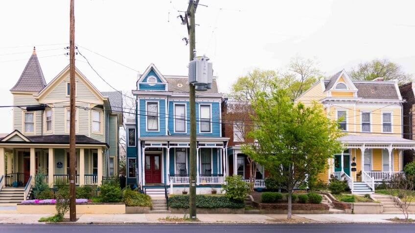 Street of bright painted colornial style homes in Richmond Virginia, USA.