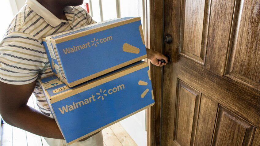 man bringing in Walmart 2-day free shipping packages