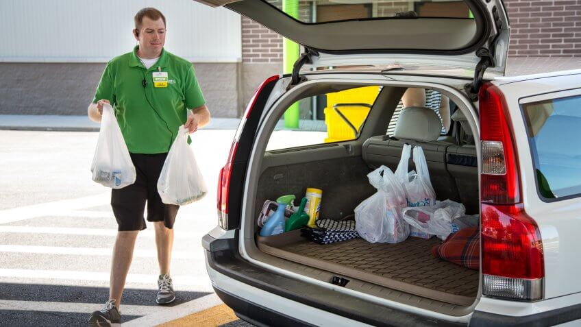 Walmart associate delivering free grocery pickup to customer