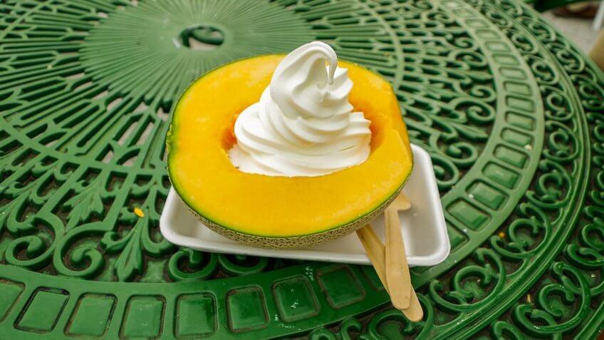 Ice cream soft serve served in half a slice of Yubari King Melon