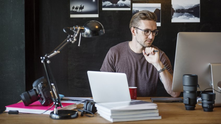 Man Busy Photographer Editing Home Office Concept.