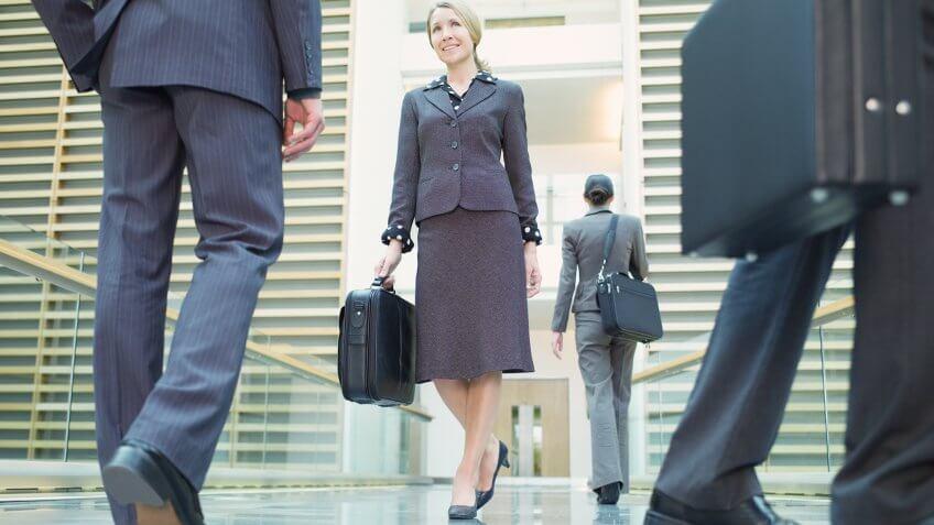 Businesspeople walking in corridor.