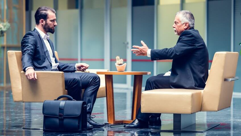 two businessmen meeting in lobby