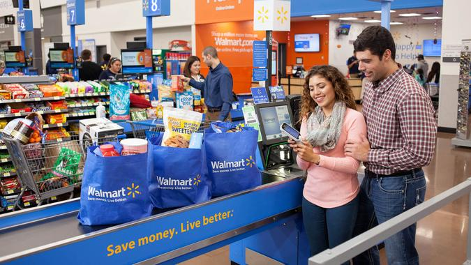 couple checking out in Walmart store