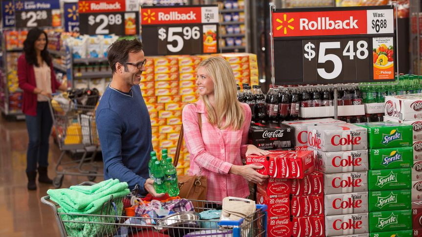 couple shopping in Walmart grocery store