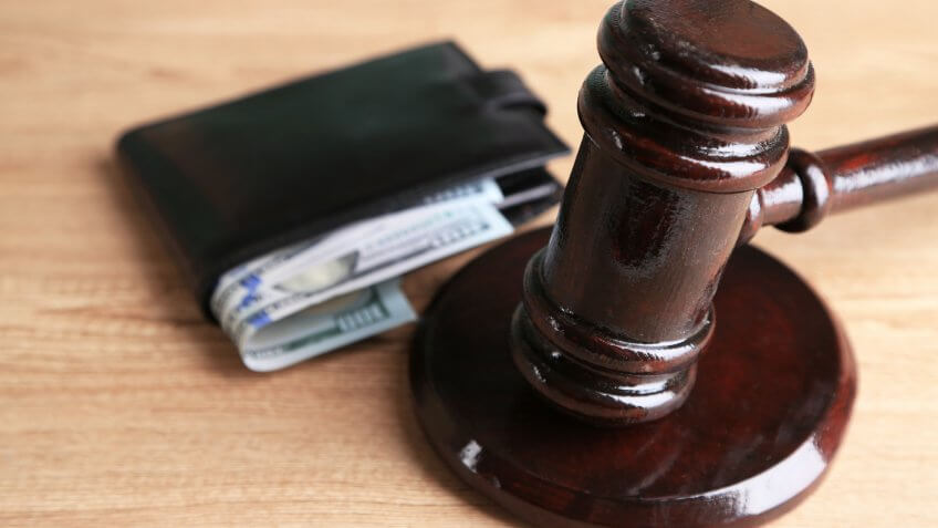 gavel with wallet and money