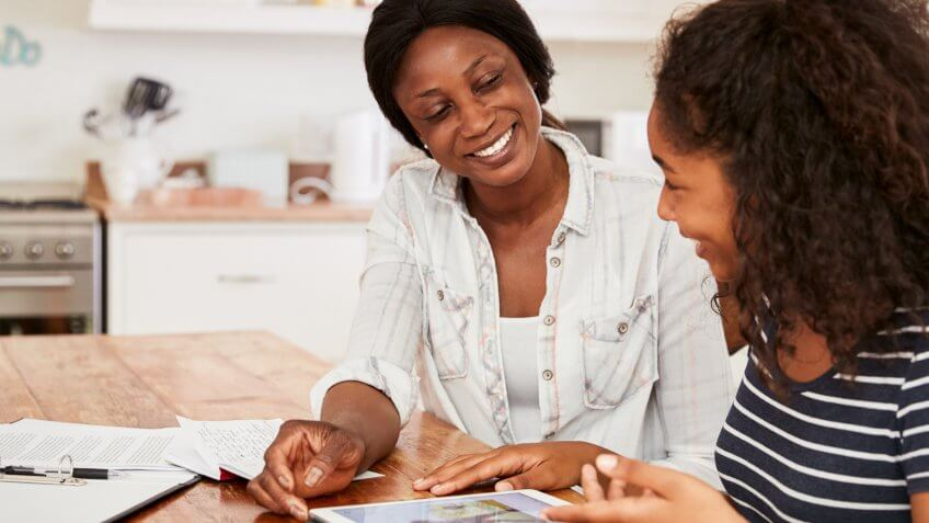 mom talking to daughter about money