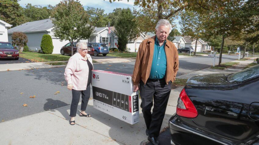 Galloway, United States - October 26, 2016: Series:Senior caucasian husband and wife have bought a new flat screen tv for there home.