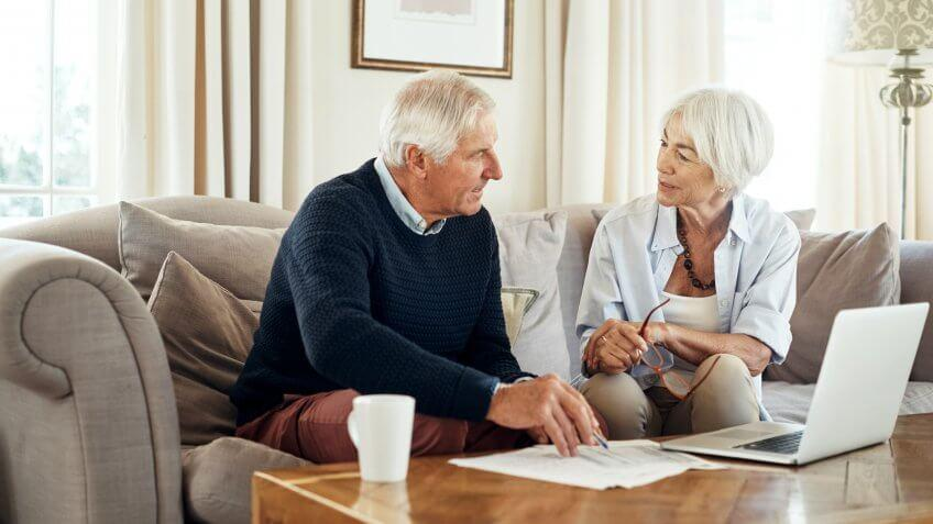 Shot of a senior couple going through their paperwork together at home.