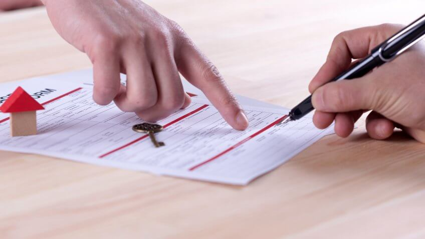 New homeowner signing contract of house sale or mortgage papers.