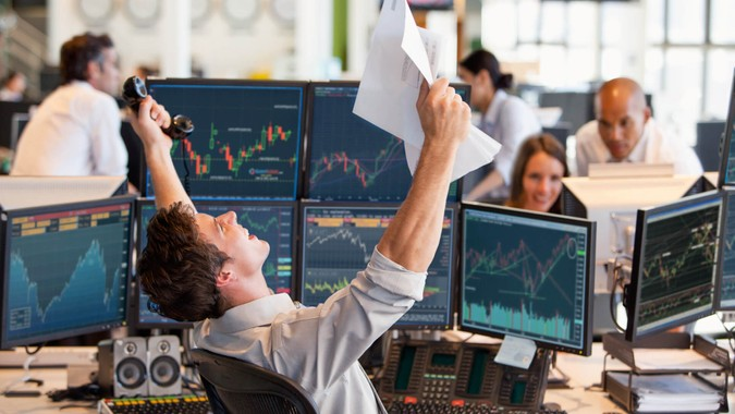 successful male day trader winning a trade