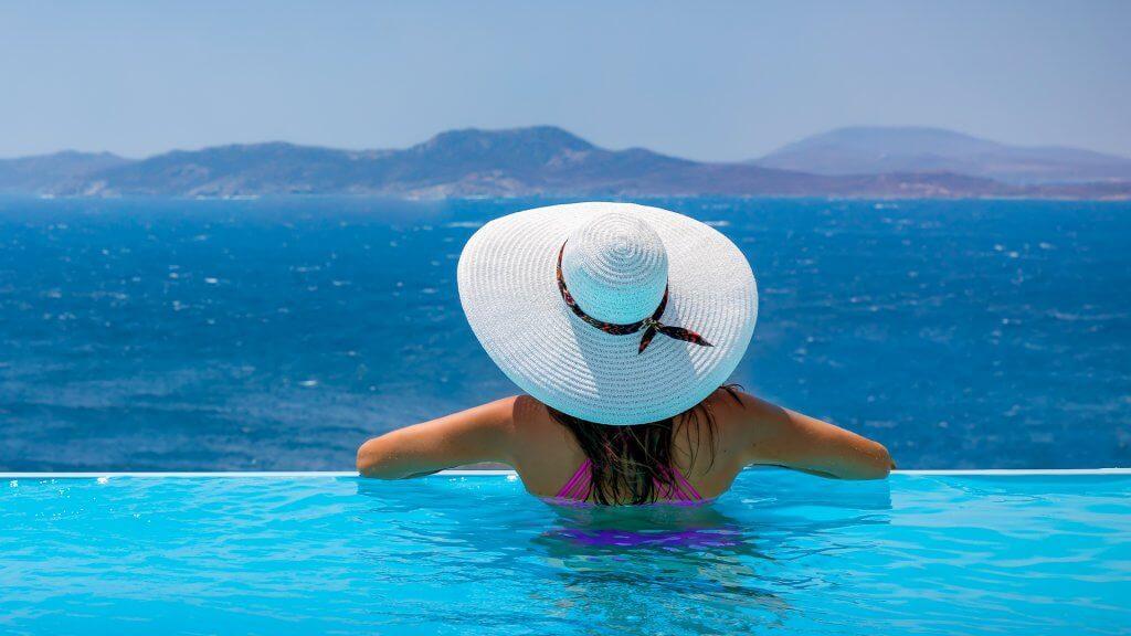 woman enjoying view from Mykonos infinite pool