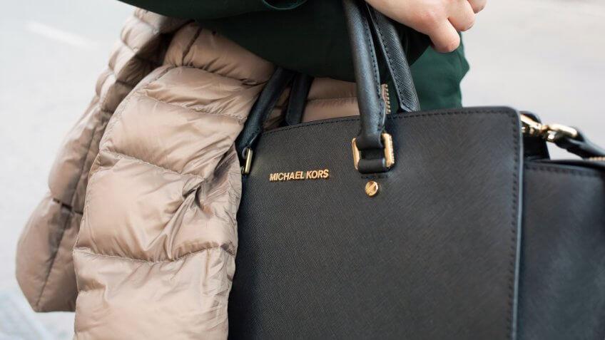 woman with fashionable Michael Kors purse
