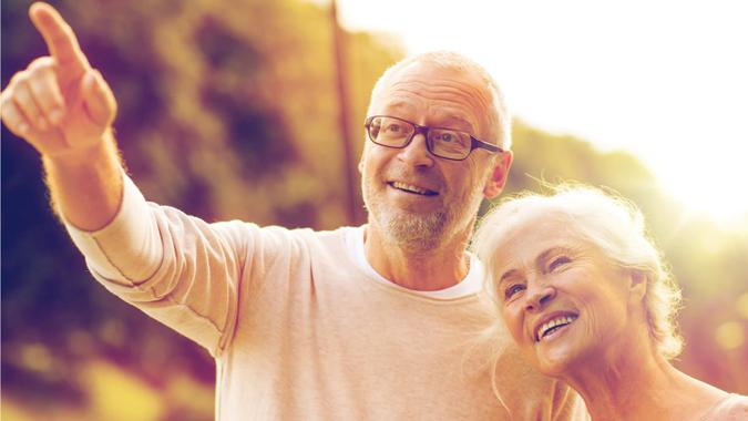 couple looking forward to the future and contemplating their retirement age and social security