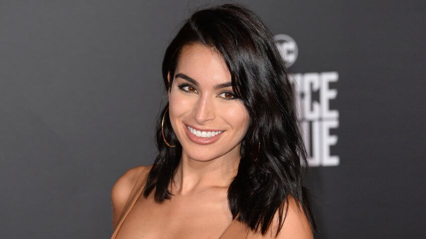 """LOS ANGELES, CA - November 13, 2017: Ashley Iaconetti at the world premiere for """"Justice League"""" at The Dolby Theatre, Hollywood."""