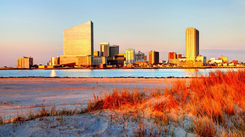 Atlantic City skyline hotel casinos from a scenic beach.