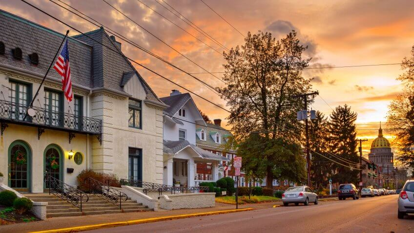 Residential street in downtown Charleston, West Virginia with the Capitol building in the background at sunrise.