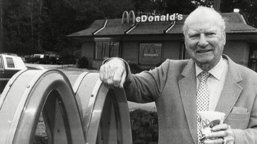 """Photo by JON LASSEIGH/AP/REX/ShutterstockMCDONALD Richard """"Dick"""" McDonald stands in front of a McDonald's restaurant in Manchester, N."""