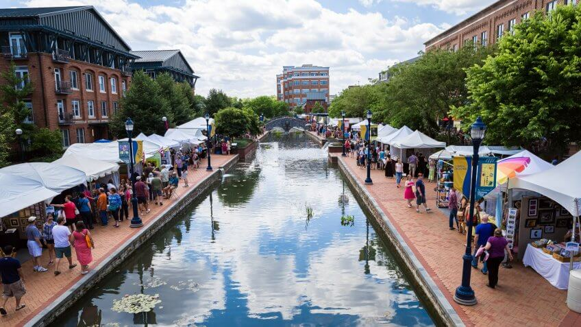 Frederick, MD, USA - June 7, 2014: People gather on the walkway at Frederick Maryland's Linear Creek to celebrate Frederick's annual Festival of the Arts.
