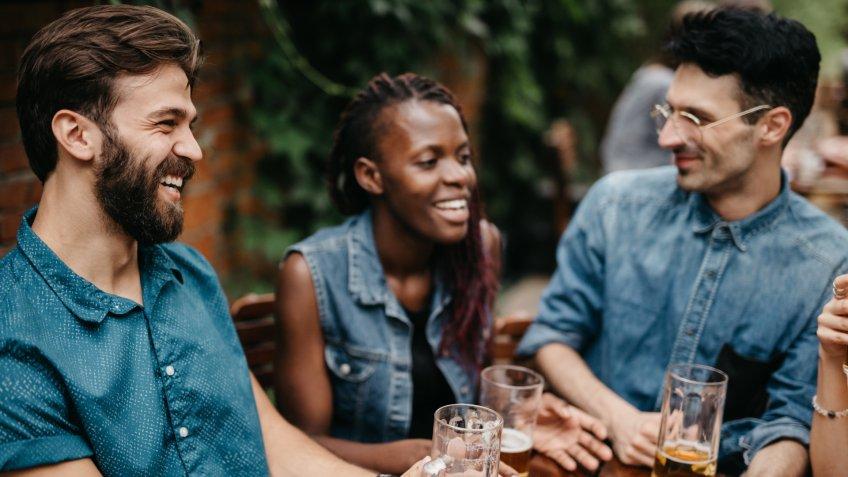 Friends burst in laugh at the pub