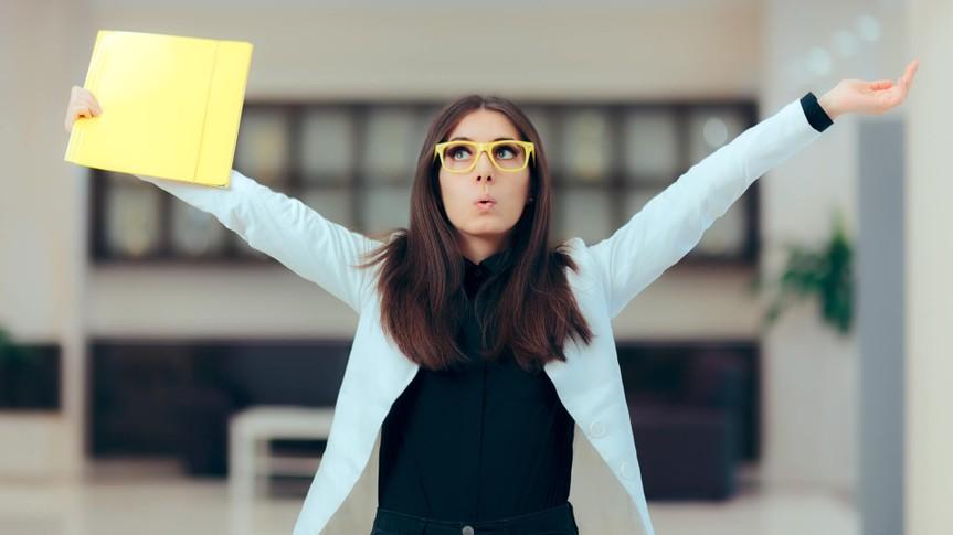 Funny enthusiastic female executive celebrating professional achievement.
