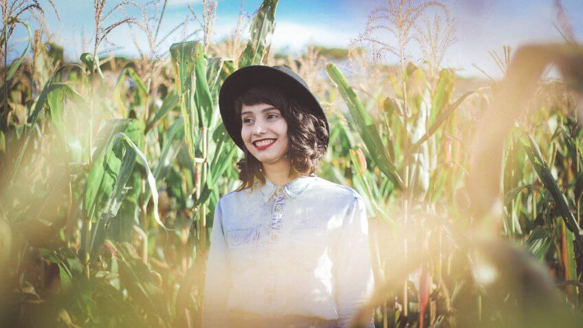 Hipster girl in the corn fields of Iowa