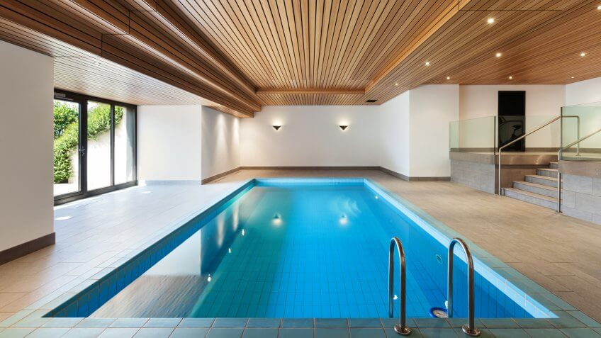 luxury apartment with indoor pool, wooden ceiling.
