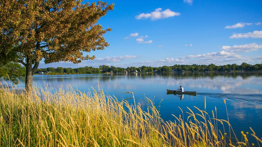 Canoeing on Lake Monona in Madison, Wisconsin as captured from Bringham Park.