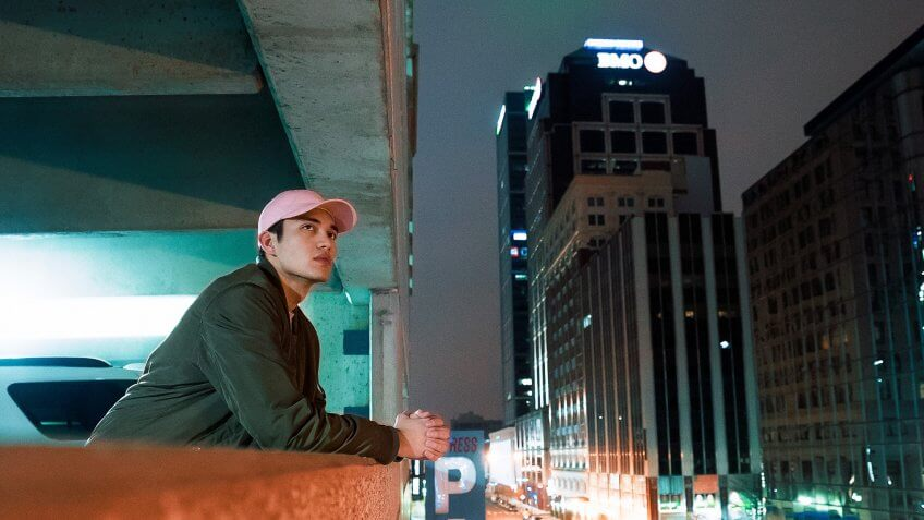 Man observing the city from the parking structure in Indiana