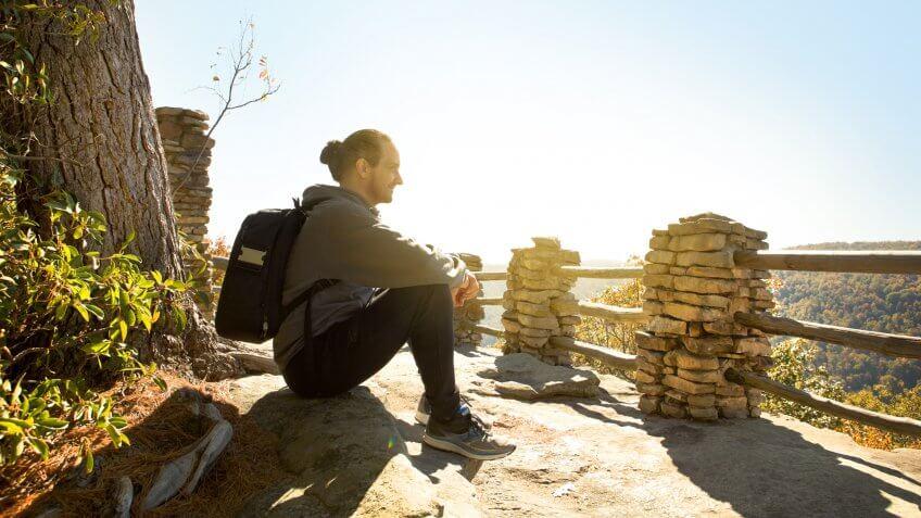 A man enjoying a beautiful fall morning outdoors.