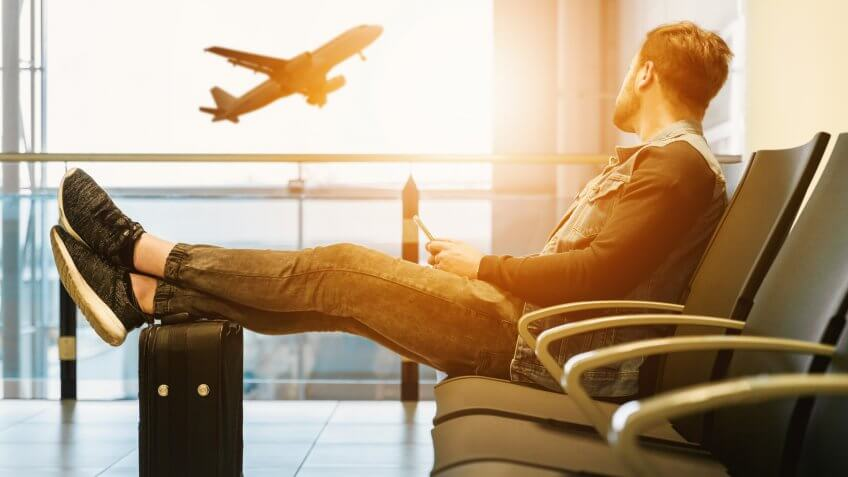 Man watching plane take off from the airport