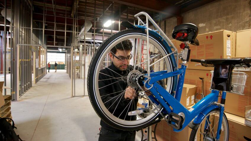 Philadelphia, PA, USA - March 31, 2015; Philly Bike Share Head Mechanic Jake Siemiarowski is seen assembling an Indego Bike for the Philly bike share program, at the Indego Headquarters in the Northern Liberties neighborhood of Philadelphia.