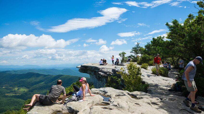 Catawba, Virginia, USA  - September 1, 2014: Hikers enjoy the view of the Appalachian Mountains from McAfee Knob on Catawba Mountain, near Roanoke, Virginia.