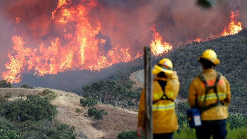 Mandatory Credit: Photo by JOHN G MABANGLO/EPA-EFE/REX/Shutterstock (9775255d)A hillside erupts in flames from the River Fire as fire fighters look on in Lakeport, California, USA, 31 July 2018.