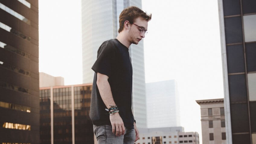 Millennial walking on rooftop in downtown Oklahoma
