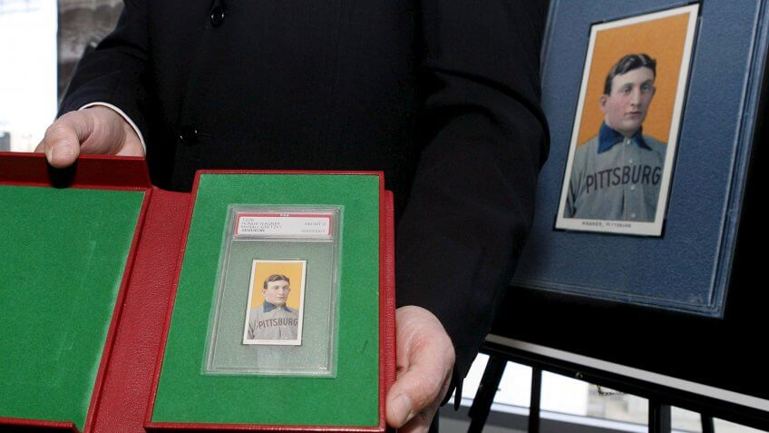 Photo by Paul Buck/EPA/REX/Shutterstock The T206 Honus Wagner Baseball Card is Displayed by Auction Company Officials at a Dodger Stadium Press Conference Announcing the Sale of the Card in Los Angeles California