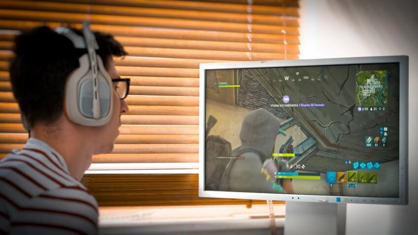 Mandatory Credit: Photo by Steve Meddle/REX/Shutterstock (9722617f)Teenager playing Fortnite video game, Fortnite is a web based multi player survival game developed by Epic Games.