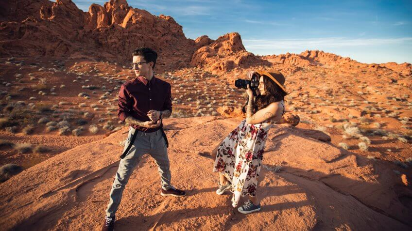 Tourists doing a photography shoot in the red rocks area of Nevada