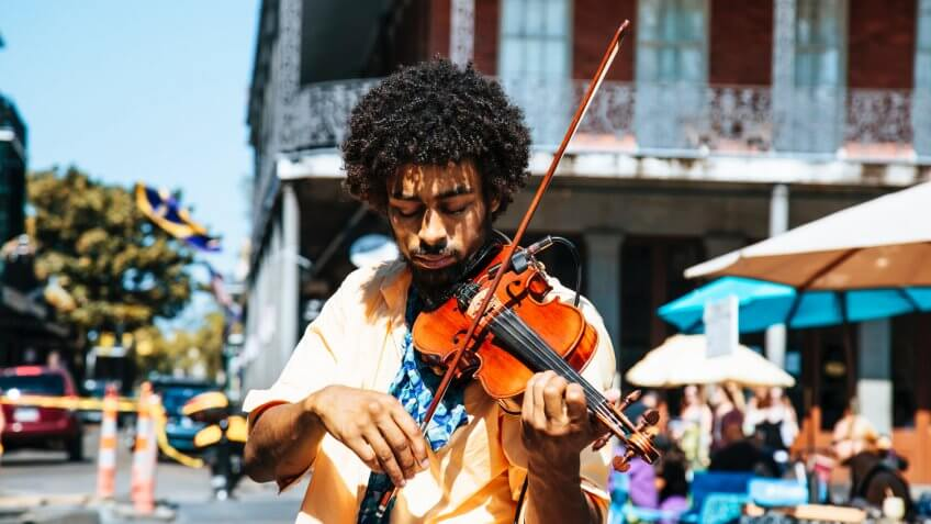 Violinist playing outside in public in Louisiana