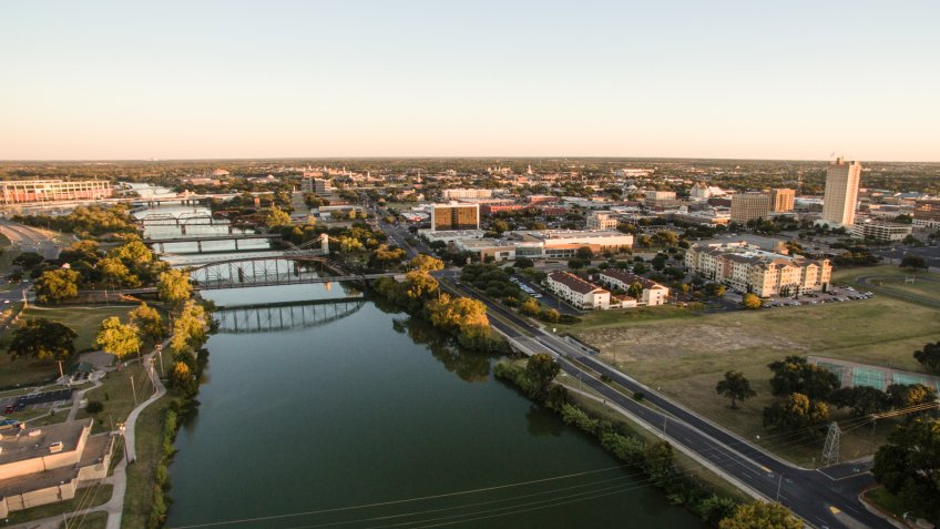 Sunset come to Waco Texas and the downtown river front.