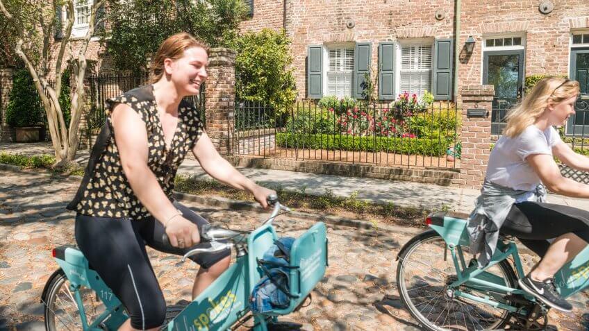 People Ride Bicycles on Historic Street Charleston South Carolina