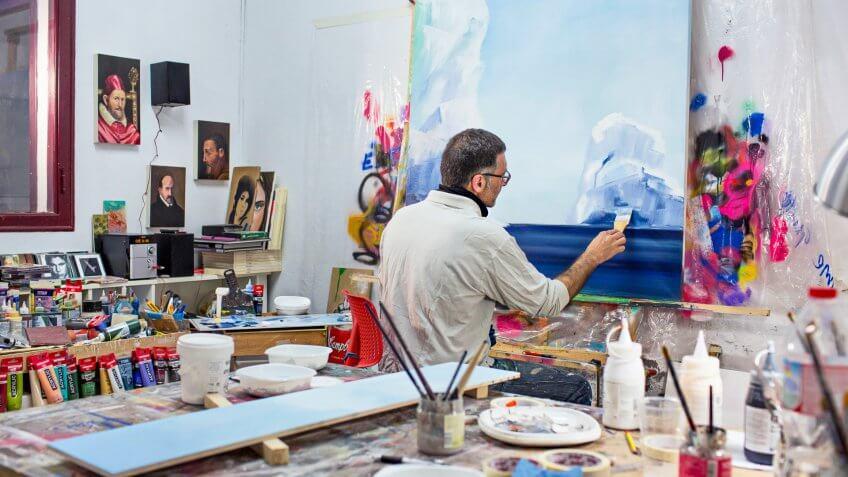 Mature artist businessman on his art studio.