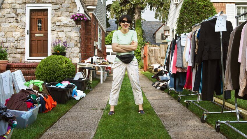 asian woman hosting yard sale