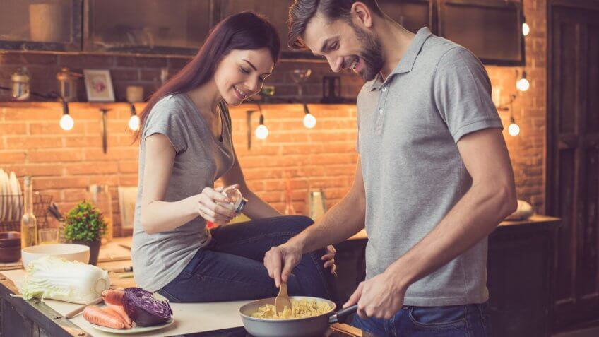 Young beautiful couple in kitchen.
