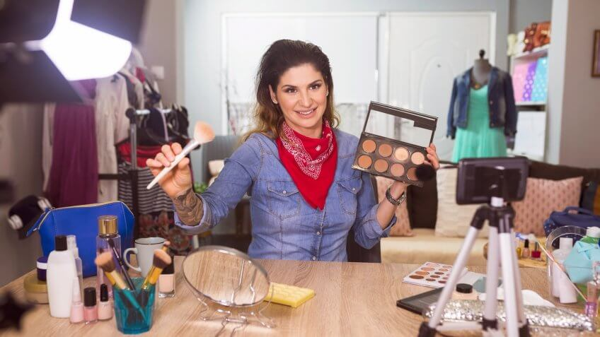 Fashion stylist  vlooger filming in fashion studio.