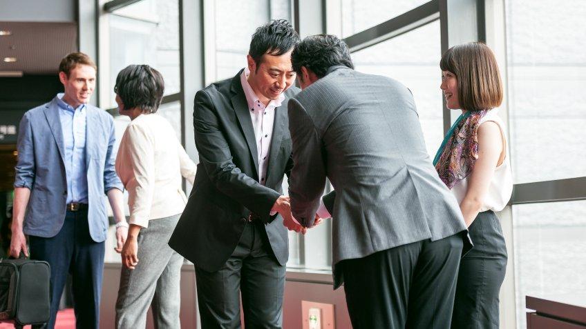 Business folk group talks in the business hall,Kyoto,Japan,Nikon D3x.