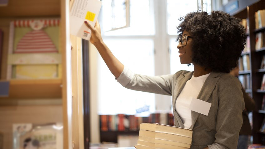 African woman working at her own bookstore.