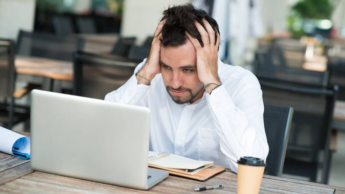 frustrated man with laptop
