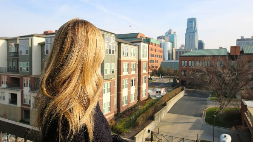 blonde looking at KC skyline.