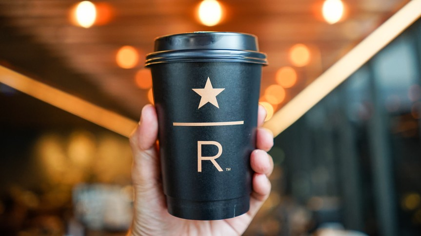hand holding Starbucks Reserve coffee cup